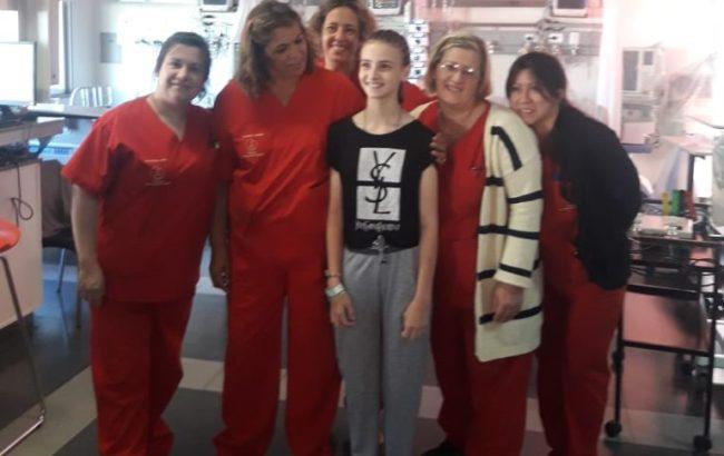 Margarita antes de retirarse junto a personal del centro de salud de quien se gano el cariño